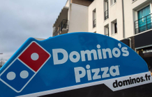 Domino's Pizza tests a button to have their favorite pizza delivered